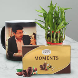 Amusing Personalized Photo Magic Mug with Ferrero Rocher N Bamboo Plant to Aizwal