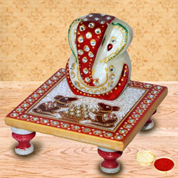 Delicately carved marbel designer ganesh with chowki with free Roli Tilak and Chawal to Anand