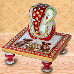 Delicately carved marbel designer ganesh with chowki to Badgam
