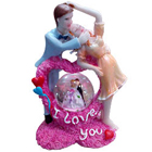 Love is Life Couple with LED Lighted Crystal Globe Showpiece to Delhi