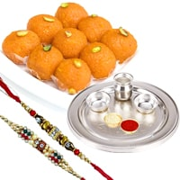 Bounty-to-Captivate Silver Plated Thali with Haldiram Ghee Ladoo & 2 Designer Rakhi and Roli Tilak Chawal to Amravati