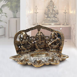 Unique Metallic Diya with Ganesh, Lakshmi N Saraswati Idol to Adra