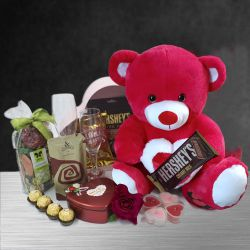 Dazzling Candle Lit Romantic Evening Hamper with Teddy n Imported Chocolates to Aizwal