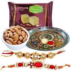 Pleasing Combo Of 2 Rakhi Set, Designer Pooja Thali With Soan Papdi And Almonds to Rakhi_to_newzealand.asp