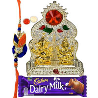 Beautiful Silver Plated Mandap with Golden Ganesh Laxmi Idol and Cadbury Dairy Milk Chocolate with Rakhi and Roli Tilak Chawal to Cochin