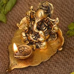 Marvelous Ganesha on Leaf with Diya to Aizawl