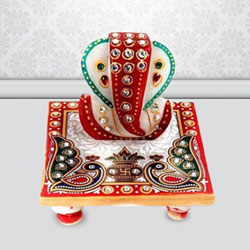 Exclusive Marble Ganesh Chowki with Peacock Design to Adra