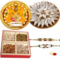Tasty Kaju Katli from Haldiram, Dry fruiits along with Pooja thali having 2 free Rakhi, Roli Tilak and Chawal  to Bangalore