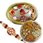 Assorted Dry Fruits Delight with Golden Plated Thali along  free Rakhi , Roli Tilak and Chawal  to India