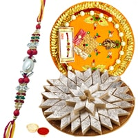 Delicious Haldiram Kaju Katli and Designer Pooja Thali along Rakhi, Roli Tilak and Chawal to Ahmadnagar