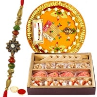 Haldiram Assorted Sweets and Designer Pooja Thali along Rakhi, Roli Tilak and Chawal to India
