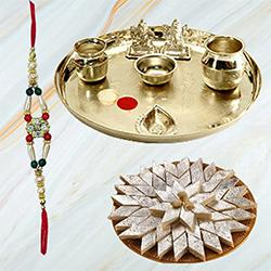 Delicious Haldiram Kaju Katli and Stylish and Trendy looking Silver Plated Paan Shaped Puja Aarti Thali (weight 52 gms) along Rakhi, Roli Tilak and Chawal to Ahmadnagar