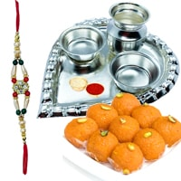 Haldiram Laddoo and Stylish and Trendy looking Silver Plated Paan Shaped Puja Aarti Thali (weight 52 gms) along Rakhi, Roli Tilak and Chawal to Bangalore