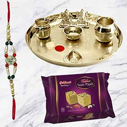 Haldiram Soan Papri and Stylish and Trendy looking Silver Plated Paan Shaped Puja Aarti Thali (weight 52 gms) along Rakhi, Roli Tilak and Chawal to India