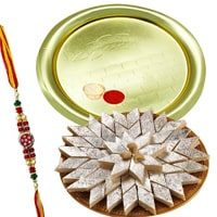 Haldiram Kaju Katli and Gold Plated Puja Thali along Rakhi, Roli Tilak and Chawal to Ahmadnagar