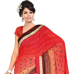 Smashing Fire Orange, Cream and Brown Georgette Printed Saree to India