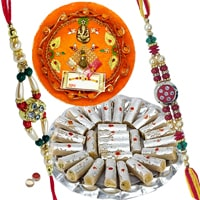 Rakhi Thali with Rakhis, Kaju Pista Roll and Roli Tikka<br><font color=#0000FF>Free Delivery in USA</font> to Stateusa.asp
