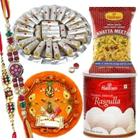 Rakhi Thali with Rakhis, Haldirams Rasgulla, Kaju Pista Roll n Chanachur<br><font color=#0000FF>Free Delivery in USA</font> to Rakhi_thali_usa.asp