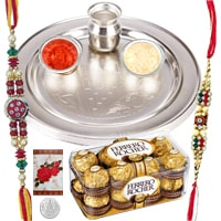 Rakhi Thali with Rakhis,12 piece Ferrero Rocher and Roli Tikka<br><font color=#0000FF>Free Delivery in USA</font> to Rakhi_to_usa.asp