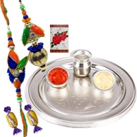 Silver Plated Rakhi Thali with 1 set Bhaiya n Bhabhi Rakhi and 2 Chocolates<br /><font color=#0000FF>Free Delivery in USA</font> to Rakhi_to_usa.asp