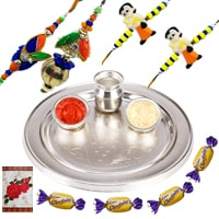 Silver Plated Rakhi Thali with 1 Set Bhaiya n Bhabhi Rakhi, 2 Kids Rakhi and 4 Chocolates<br /><font color=#0000FF>Free Delivery in USA</font> to Stateusa.asp