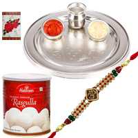 Silver Plated Thali with One Om/Ganesh Rakhi n Haldirams Rasgulla<br /><font color=#0000FF>Free Delivery in USA</font> to Rakhi_thali_usa.asp