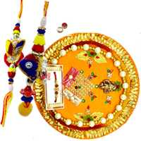 Thali with bhaiya-bhabhi pair<br><font color=#0000FF>Free Delivery in USA</font> to Rakhi_thali_usa.asp