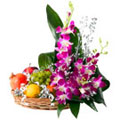 Mouth-watering assorted Fruit basket with charming Flowers  to Gurgaon