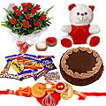 Wonderful Roses, Cake, Chocolates and Teddy along with Free Rakhi, Roli Tika and Chawal to Bangalore