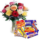 12 mixed roses in a vase With Cadbury Chocolate Celebration Assorted Pack to Gurgaon