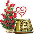 A basket of red roses annd sweets for dear mom to Chennai