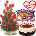 18 Dutch Red Roses Bouquet with 1 Lbs. Black Forest Cake and 1 Cadbury's Celebration to Udaipur